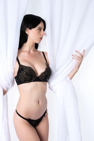 undergarment: Tall slender brunette dressed in black lingerie