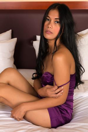 purple dress: Beautiful petite Filipino woman in a purple dress
