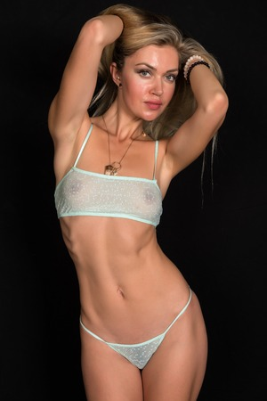Beautiful tall Russian blonde in sheer teal lingerie