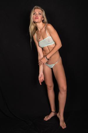 sheer: Beautiful tall Russian blonde in sheer teal lingerie