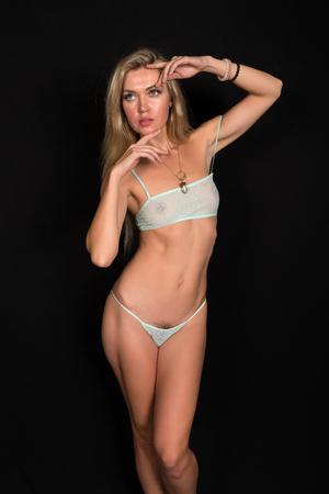 undergarment: Beautiful tall Russian blonde in sheer teal lingerie