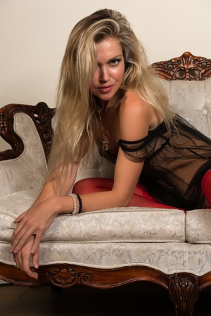 negligee: Beautiful tall Russian blonde in a sheer brown negligee Stock Photo