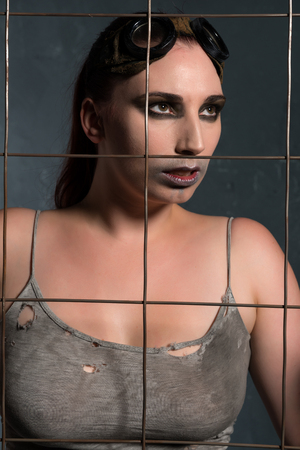 cosplay: Cosplay warrior behind a wire mesh fence
