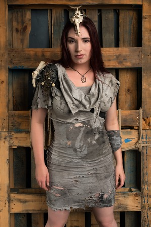 shapely: Shapely young brunette in a ragged gray dress