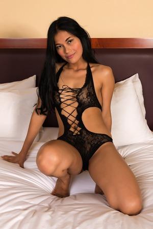 undergarment: Beautiful petite Filipino woman in a black fishnet bodysuit