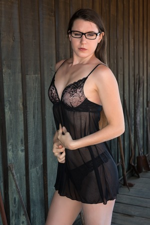 Pretty young brunette in a black negligee Banco de Imagens