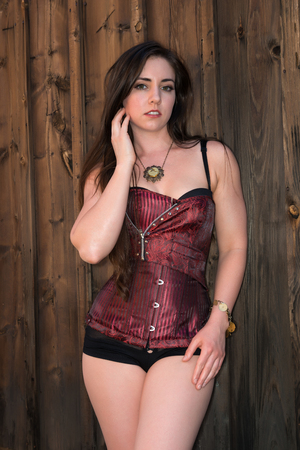 Pretty petite brunette in a purple bustier