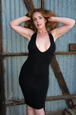 Beautiful tall redhead in a black dress