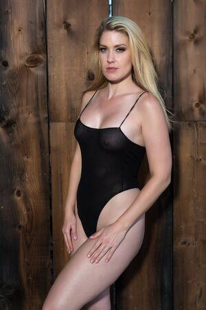 Beautiful blonde woman in a black bodysuit