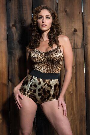 leopard print lingerie: Beautiful shapely brunette in a leopard print bodysuit