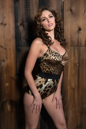 undergarment: Beautiful shapely brunette in a leopard print bodysuit