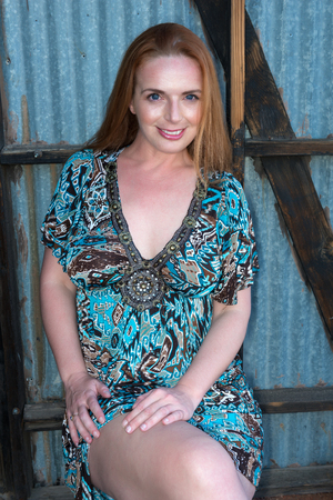 Beautiful tall redhead in a turquoise dress