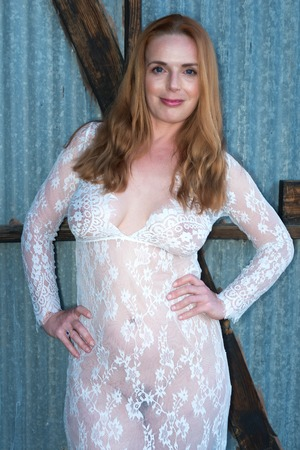Beautiful tall redhead in a sheer white gown