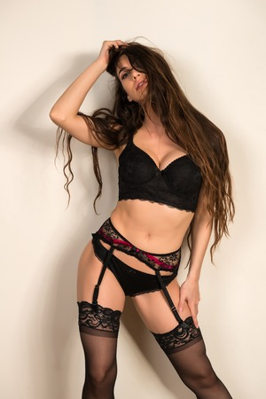 panty hose: Pretty young brunette in black lingerie