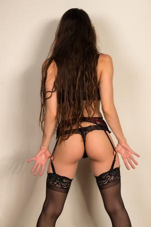 garters: Pretty young brunette in black lingerie