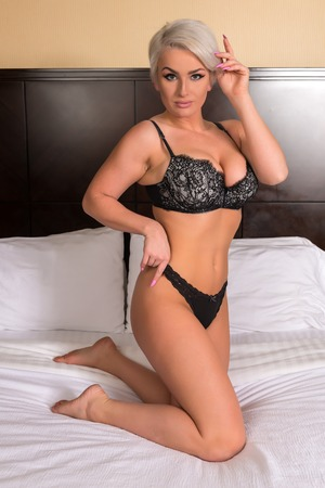 undergarment: Beautiful shapely blonde in black lingerie