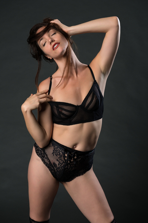 undergarment: Beautiful tall brunette dressed in black lingerie