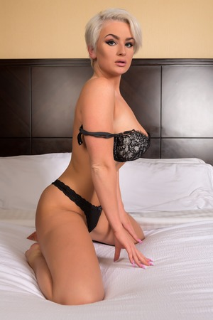 Beautiful shapely blonde in black lingerie