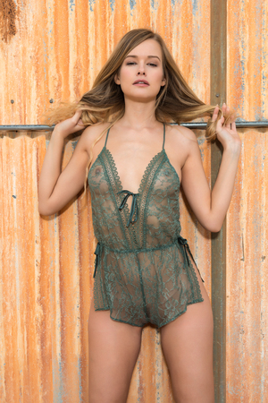 undergarment: Beautiful slender blonde in a forest green bodysuit Stock Photo