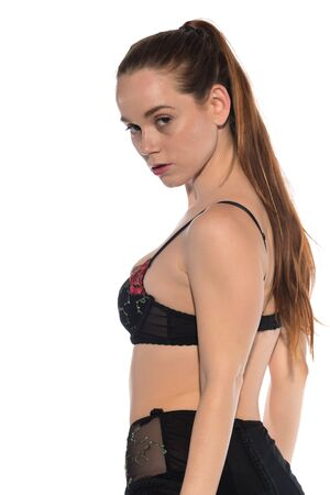 Tall slender redhead in red and black lingerie Stock Photo