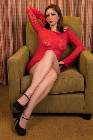 Beautiful brunette in a sheer red dress