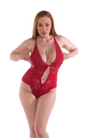 Curvy young redhead in a red lace bodysuit 免版税图像 - 80766887