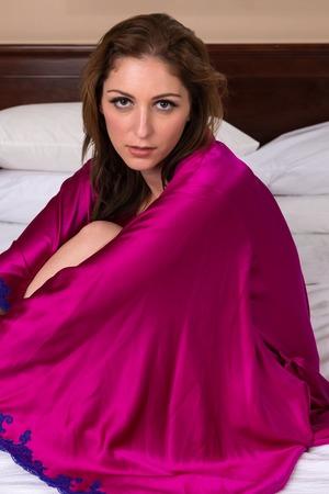 Beautiful brunette nude under a purple robe Stok Fotoğraf