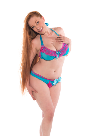 Curvy young redhead in blue and purple lingerie 免版税图像 - 80943703