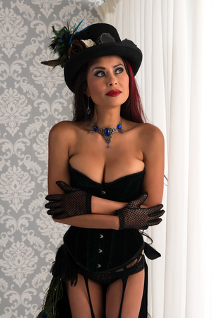 bodice: Beautiful mature redhead dressed in a sexy steampunk outfit Stock Photo
