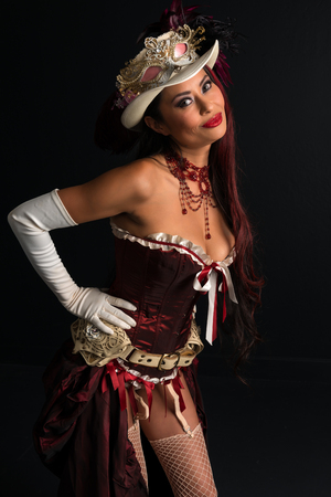 Beautiful mature redhead dressed in a sexy steampunk outfit Stock fotó