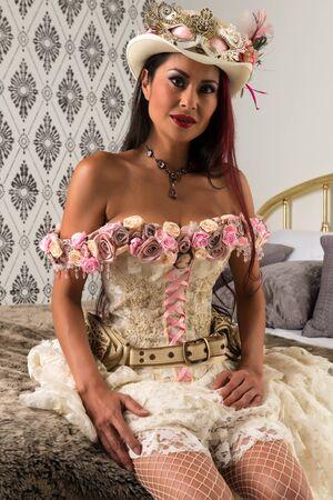 Beautiful mature redhead in a steampunk wedding dress Stock Photo