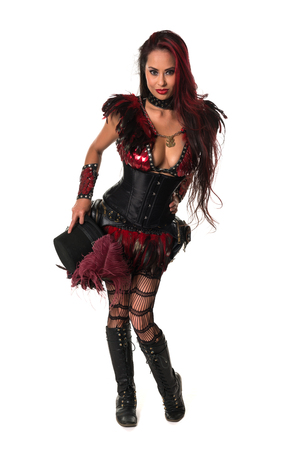 steampunk goggles: Beautiful mature redhead dressed in a sexy steampunk outfit Stock Photo
