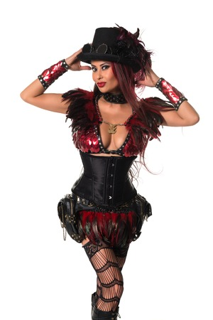 Beautiful mature redhead dressed in a sexy steampunk outfit Imagens