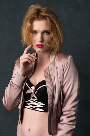 Pretty blonde woman in a bustier top and jacket Stock Photo