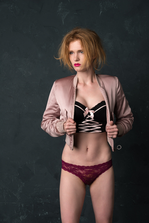 Pretty  blonde woman in a bustier top and jacket