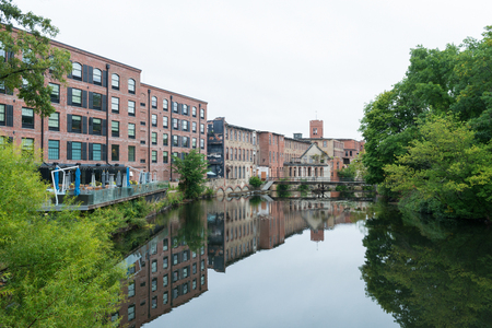 Restored and abandoned cotton mill buildings on the Pawtuxet River, Warwick, Rhode Island