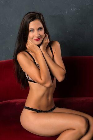 Beautiful tall Czech brunette dressed in sheer lingerie