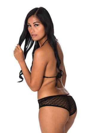 undergarment: Beautiful petite Filipino woman in a sheer black bodysuit