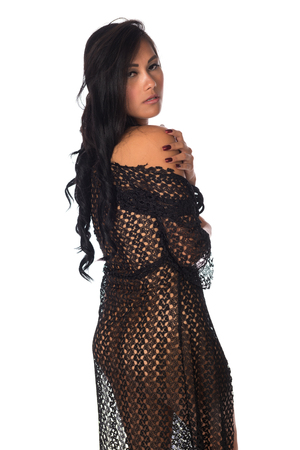 Beautiful petite Filipino woman nude under a black lace wrap Stock Photo - 87977826