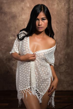 Beautiful petite Filipino woman nude under a white wrap