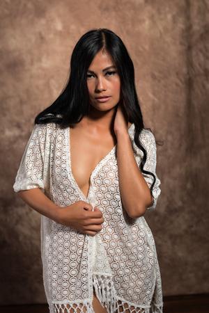 Beautiful petite Filipino woman under a white wrap