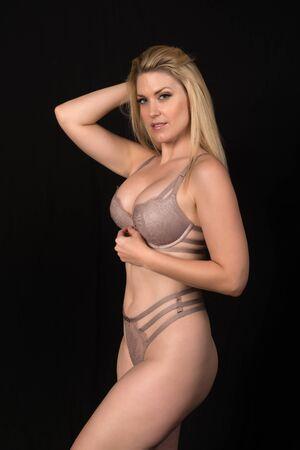 Beautiful pale blonde in mauve lingerie