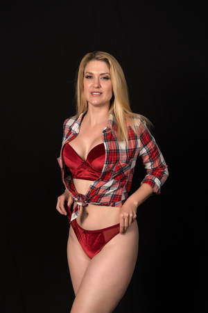Beautiful pale blonde in red lingerie and a plaid blouse