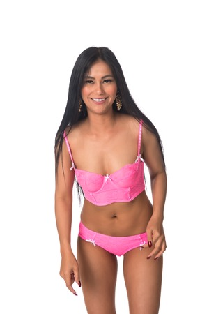 Beautiful petite Filipino woman in pink lingerie 写真素材