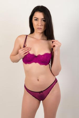 Pretty petite brunette in purple lingerie