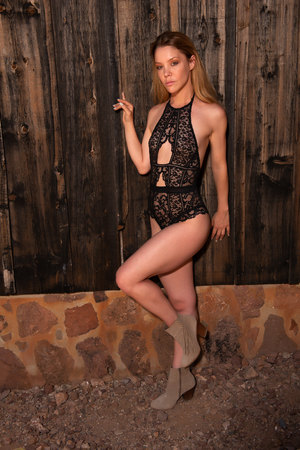 Pretty slender blonde in a black lace bodysuit