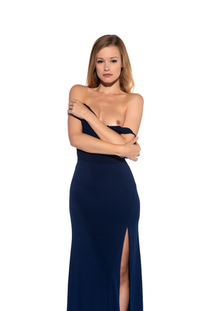 Tall slender blonde in a long blue gown Stock Photo