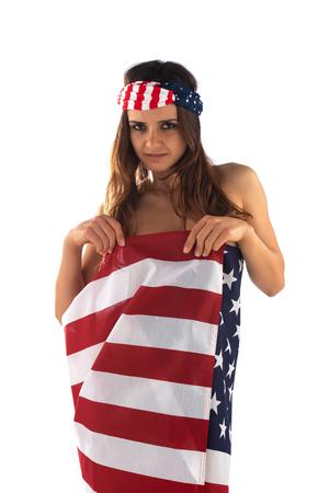 Dark skinned Romanian brunette wrapped in an American flag Banco de Imagens