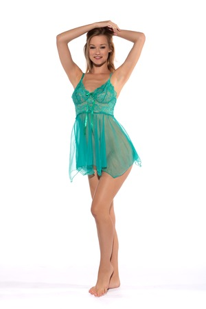 Tall slender blonde in a teal nightgown