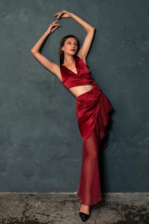 Tall slender Ukrainian brunette in a bright red dress